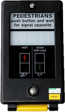 The common UK pedestrian crossing button box